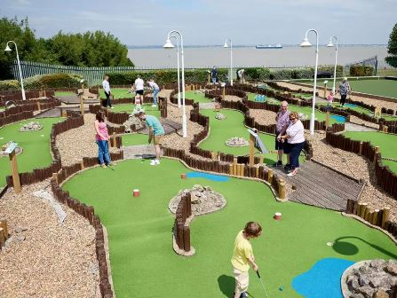 Families playing crazy golf at Haven Allhallows Holiday Park
