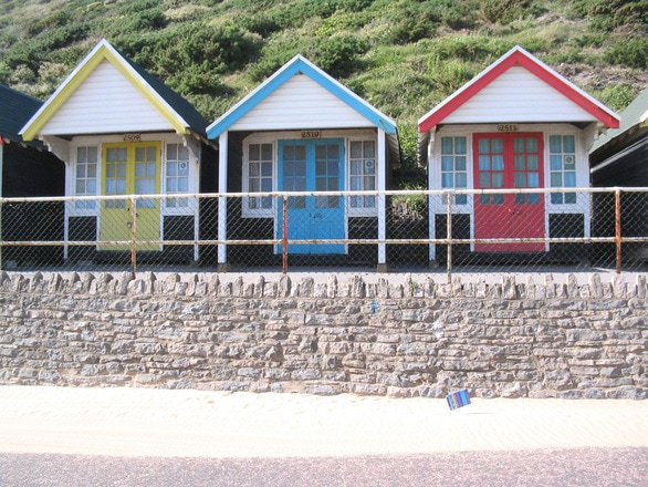 Beach huts in yellow blue and red