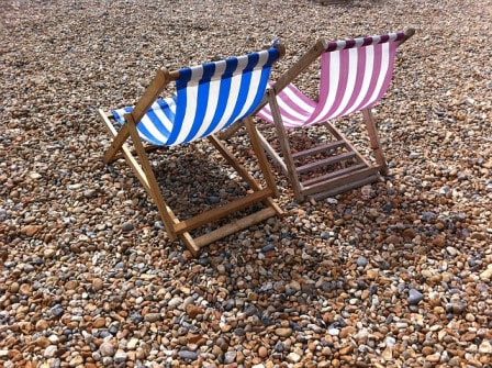 Deckchairs on a shingly beach