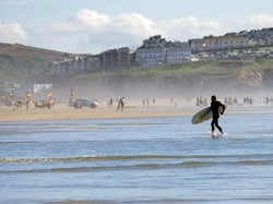 Surfers at Penhale sands Cornwall